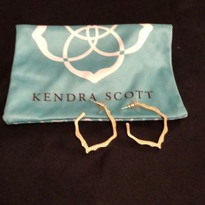 Kendra Scott gold textured earrings.